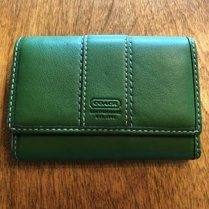 green and blue Coach wallet